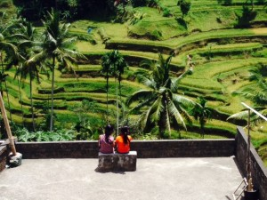 """Ed snapped this fabulous photo of two girls sitting in front of """"the famous rice paddys photographed all the time."""""""
