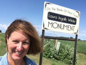 Posing by monument sign